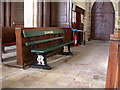 TL3163 : Elsbridge station bench in Elsworth church by Keith Edkins