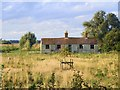 TF3101 : Disused Cottages near Poplar Farm. by Tony Bennett