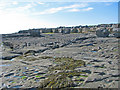 R0597 : Limestone pavement beachfront north of Doolin pier by C Michael Hogan