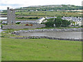 M2610 : Muckinish Castle encroached upon by modern homes by C Michael Hogan