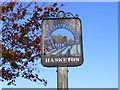 TM2450 : Hasketon Village Sign by Adrian Cable