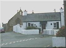 SH3568 : Pendref cottage and St Beuno's Church by Eric Jones