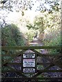 TG2626 : Private road doubling as public footpath by Evelyn Simak
