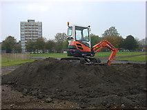 TQ3283 : Small excavator, Shoreditch Park by Oxyman
