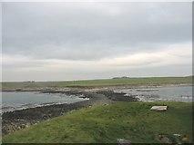 SH3368 : View landward across the causeway from St Cwyfan's Church by Eric Jones