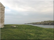 SH3368 : Old RA range buildings viewed across Porth China from St Cwyfan's Church by Eric Jones