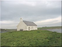 SH3368 : The whitewashed St Cwyfan's Church by Eric Jones