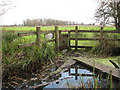 TG3326 : Tiny gate into a cattle pasture by Evelyn Simak