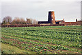 TA0253 : A disused windmill, Hutton Cranswick by Peter Church