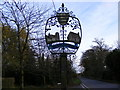 TM2460 : Brandeston Village Sign by Adrian Cable