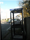 TQ0202 : Looking THROUGH the phone box in Ferry Road by Basher Eyre