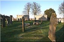 NJ2265 : Grave Slabs in Spynie Kirkyard by Anne Burgess