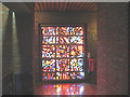 TQ3477 : Stained glass in St John's church by Stephen Craven