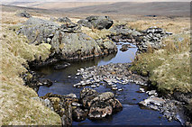 NY5009 : Remains of old bridge over Mosedale Beck by Tom Richardson