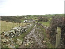 SH4094 : A muddy section of the Anglesey Coastal Path north of Castell by Eric Jones