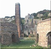 SH4094 : Kilns, chimney and silica bunkers at Porth Wen Brick Works by Eric Jones