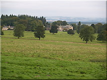 NZ0255 : Minsteracres Monastery from Barley Hill Plantation by Clive Nicholson