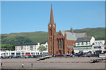 NS2059 : St Columbas Church and Nardini's cafe Largs by Jim Webster