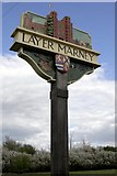TL9218 : Layer Marney village sign by Stuart Vickers
