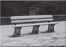 SX9193 : Snow-covered seat, St David's station, Exeter by Derek Harper