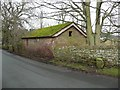 NY5045 : Farm building and boundary stone, Ainstable by Humphrey Bolton