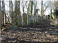 TL1488 : Gravestones, Caldecote by Michael Trolove