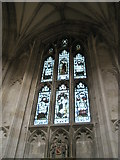 SU4829 : Stained glass window above a coat of arms on the north wall of Winchester Cathedral by Basher Eyre