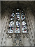 SU4829 : Stained glass window above an urn on the north wall at Winchester Cathedral by Basher Eyre