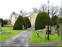 SK2572 : Church Graveyard by Tony Bacon