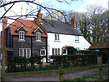 TQ1463 : Cottages on Arbrook Lane by Colin Smith
