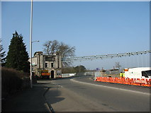 SH5571 : The sharp bend at the southern approach to Pont y Borth by Eric Jones
