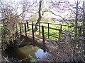 TQ7147 : Footbridge over Stream by David Anstiss