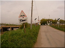 TA0623 : Barrow Haven: approaching the level crossing by Chris Downer