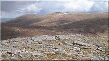 NN4547 : Rocky summit of Meall Cruinn by Richard Webb