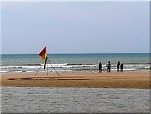 SS2006 : Paddlers and lifeguards' flag, Summerleaze beach, Bude by Tom Jolliffe