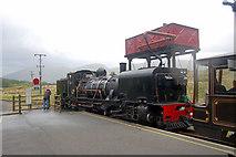 SH5752 : Water tank at Rhyd Ddu station with train by John Firth