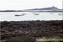 NU2424 : Dunstanburgh Castle across St Mary's by Andy Jamieson
