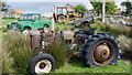 NR5774 : Collection of farm machinery at Ardmenish by Andrew Curtis