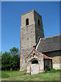 TG3203 : St Andrew's church - porch and tower by Evelyn Simak