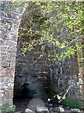 NY5764 : The arch of the lime kiln at Northrigg Hill Farm by Mike Quinn