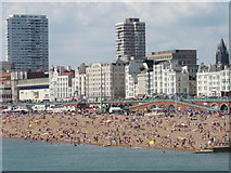 TQ3103 : Crowded Brighton beach seen from Palace Pier by David Hawgood