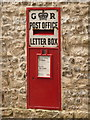 SY6892 : Charminster: postbox № DT2 121, East Hill by Chris Downer