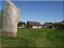 SU1070 : Standing stone and buildings at Avebury by Derek Harper