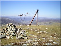 NO1577 : Meall Odhar - summit cairn and the ski tow by Richard Law