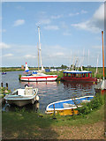 TG3504 : Boats moored by the Buckenham sailing club by Evelyn Simak