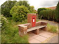 SY4793 : Bradpole: seat and postbox № DT6 34, Jessopp Avenue by Chris Downer