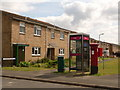 SY6889 : Dorchester: postbox № DT1 209 and phone, Celtic Crescent by Chris Downer