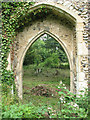 TM1685 : The ruin of St Mary's church - north doorway by Evelyn Simak