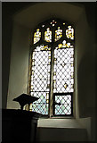 TM1582 : St George's Church - fragments of medieval glass by Evelyn Simak