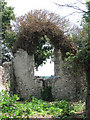 TM2398 : The ruined church of St Martin - east window by Evelyn Simak